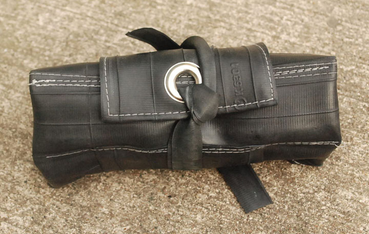 Tool roll with grommet
